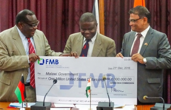 Mr. Goodall Gondwe, Minister of Finance (left), Dr. Peter Kumpalume, Minister of Health (middle), and Mr. Suresh Kumar Menon, High Commissioner(right)at a ceremony to handover the gift of US Bollars 1 million from Goverment of India tothe Goverment of Malawi on 21st December 2016.